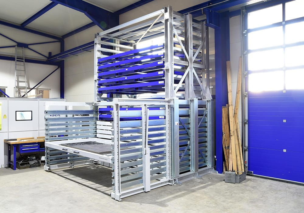 Storage system at plasma cutting machine for sheet metal plates and metal sheet packages