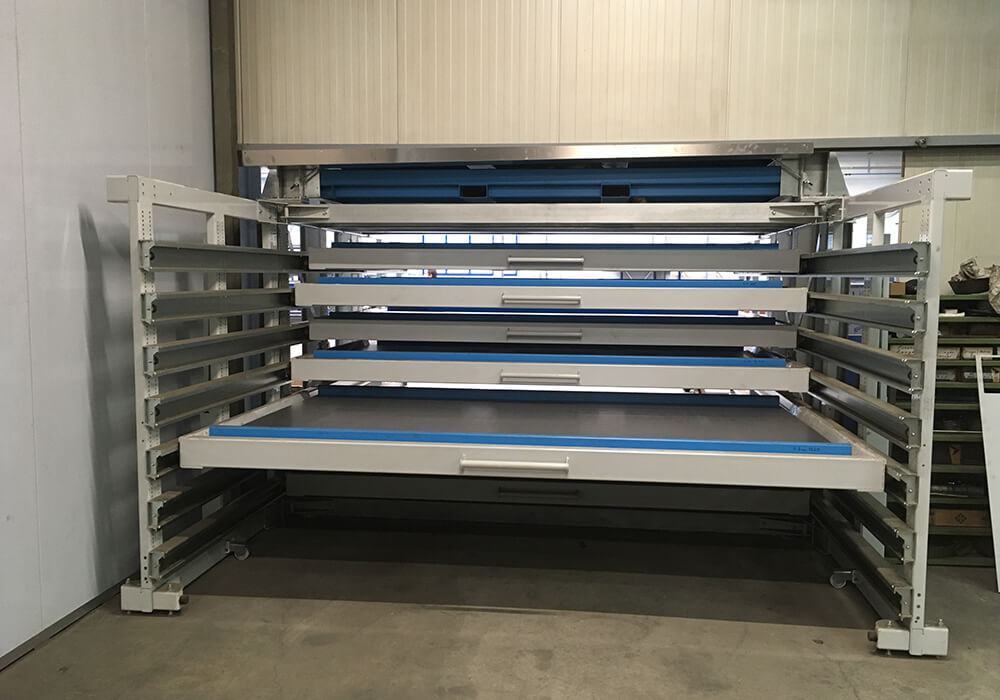 Drawer rack for sheet metal plates with wall feed-through system, sheet metal storage