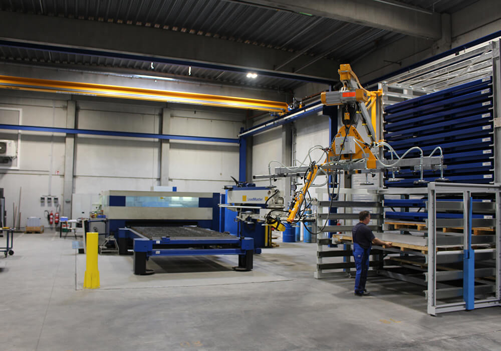 Sheet metal storage system with drawers at Trumpf laser with crane and vacuum lifter