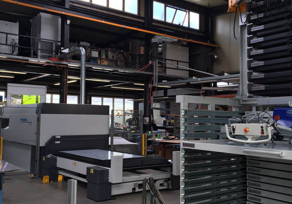 LVD laser machine is loaded with sheet metal plates from the sheet metal storage tower.